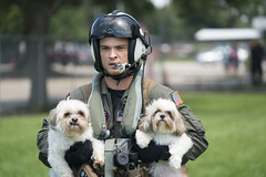 Naval Aircrewman (Helicopter) 2nd Class Jansen Schamp rescues two dogs after flood waters from Hurricane Harvey reached the grounds of a shelter.