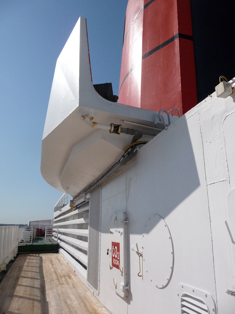 The area under the funnel scoop was a popular location for sunbathing by QE2's crewmembers.