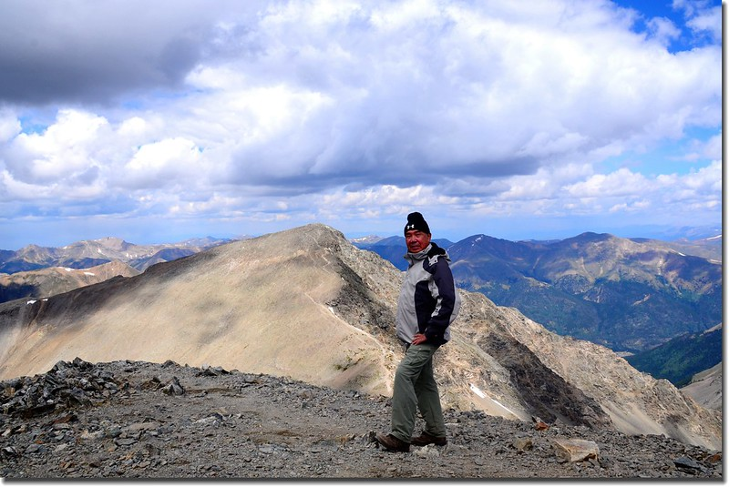 On the Grays' summit, background is Torreys Peak