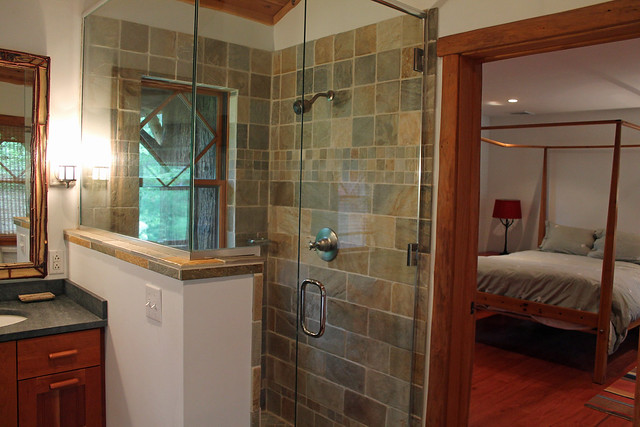 Glassed shower with custom tile;