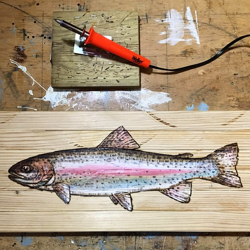 This pyrography and acrylic rainbow trout is going to a charity auction next month.