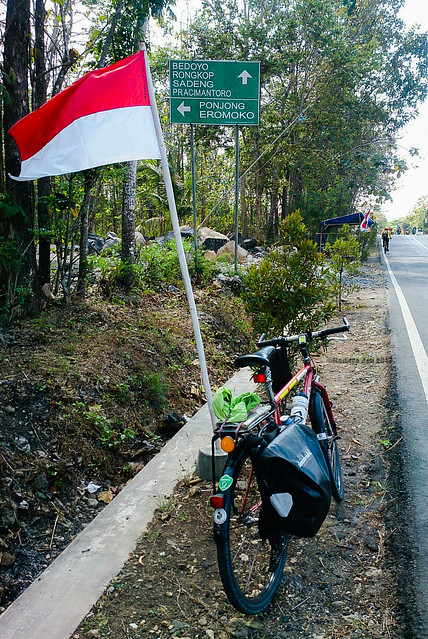 Bicycle, flag and road sign