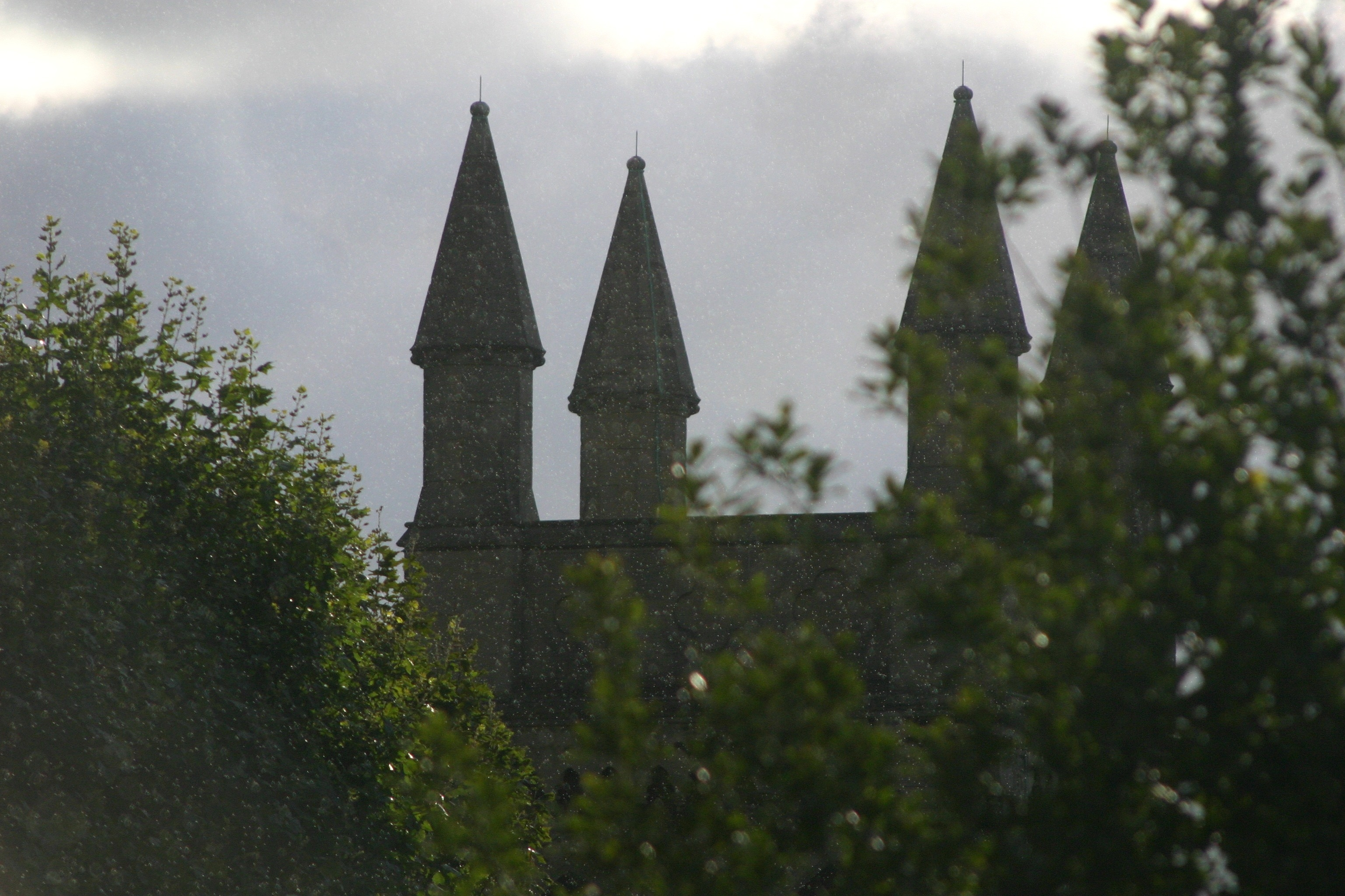 Rain falling in front of a church, 300mm lens