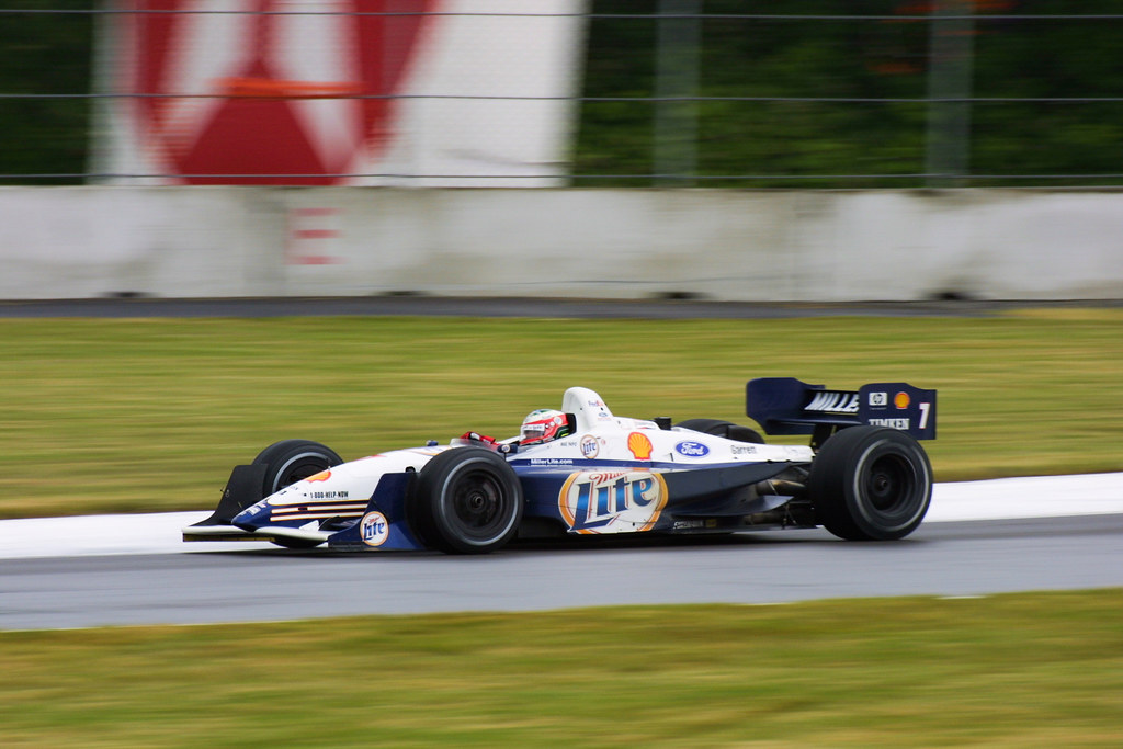Race winner Max Papis drives his Team Rahal car on a damp track at the 2001 CART race at Portland with just a few laps until the finish