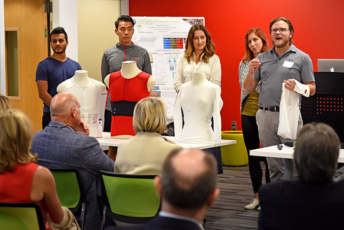 Dr. Jesse Jur (right) and researchers in Advanced Self-Powered Systems of Integrated Sensors and Technologies (ASSIST) labs present their latest work for members of the Board of Governors and other university leaders.