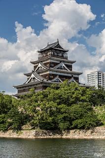 Hiroshima's castle under a heavy sun.