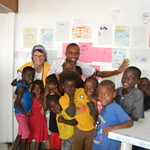 cross section of children with their drawings on the wall.