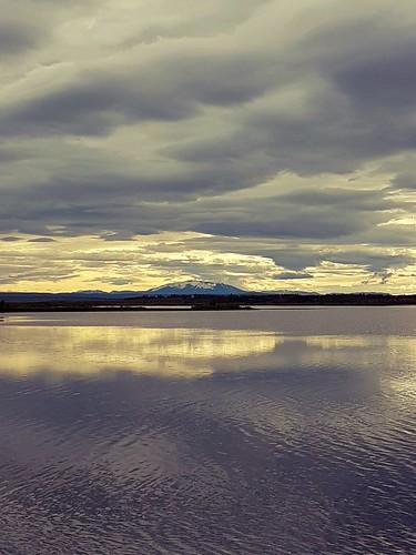 lake laugarvatn hekla iceland sunrise water reflection oeiriks