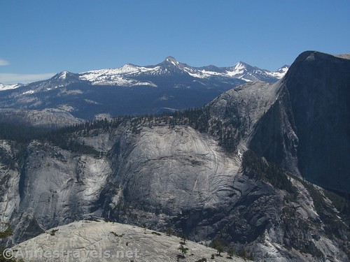 The snowy Sierras from the viewpoint along the North Dome Trail in Yosemite National Park, California