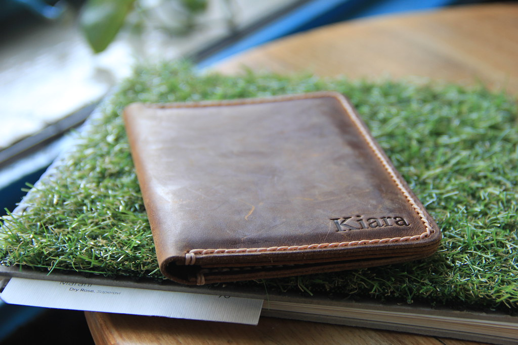 Showcasing my JooJoobs personalised leather travel wallet on Yolka's quirky grass-covered menus.