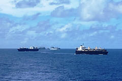 Maritime Prepositioning Ships Squadron 3 ships operate in formation off Saipan, Aug. 3. (U.S. Navy/MC3 Matt Brown)
