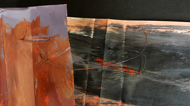 Folded painting of rock textures and rust