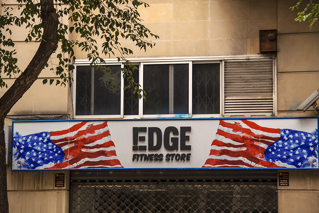 American flags on shop sign--Tarragona