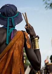 Stylish man attending Kael ceremony, Gurra, Hana Mursi, Omo Valley, Ethiopia
