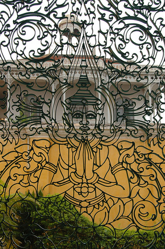A metal gate featuring Buddha in Cambodia