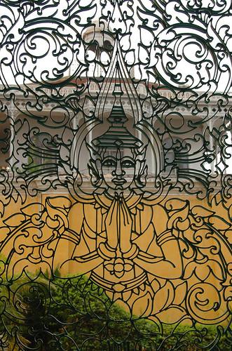 A metal gate featuring Buddha in Cambodia