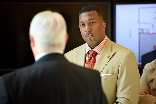 Board of Governors' Darrell Allison listens to Chancellor Randy Woodson discuss nonwovens while touring Centennial Campus.