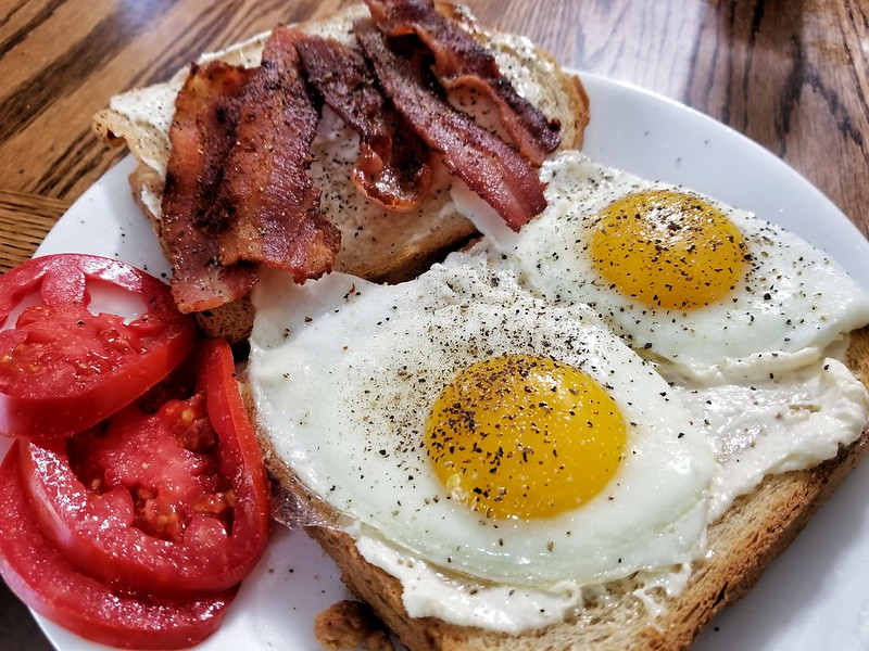 bacon and eggs on toast with mayo