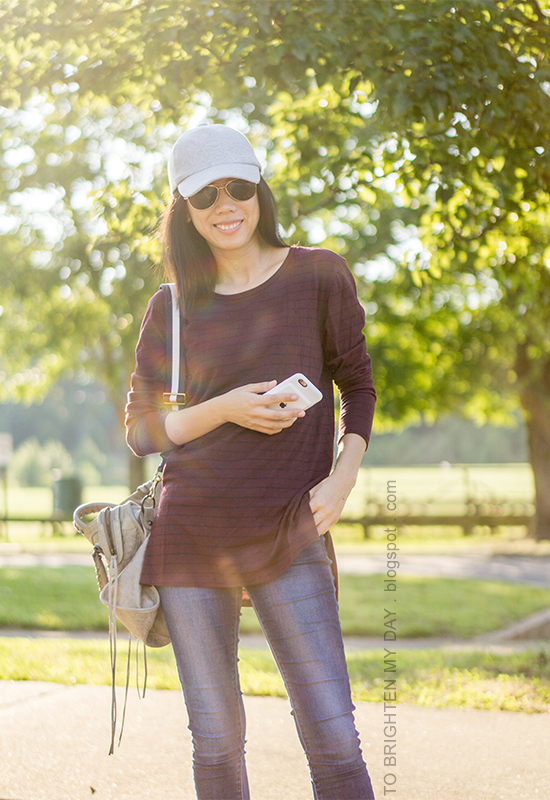 gray baseball cap, burgundy and navy striped tunic top, gray tote with navy striped strap, skinny jeans