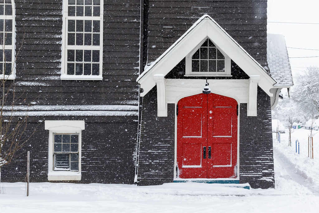 The red doors of the Door of Hope church on a snowy winter morning