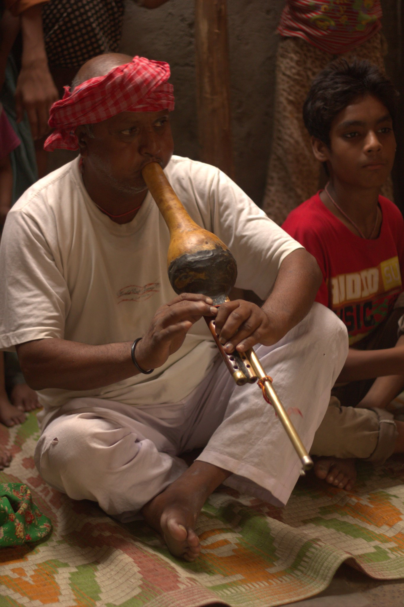 A snake charmer at Kathputli Colony