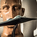 A sculpture of a human head and a model of a B-2 Spirit Bomber in a lab at the 711th Human Performance Wing at the Air Force Research Laboratory at Wright Patterson Air Force Base in Dayton, Ohio. (U.S. Air Force photo by J.M. Eddins Jr.)