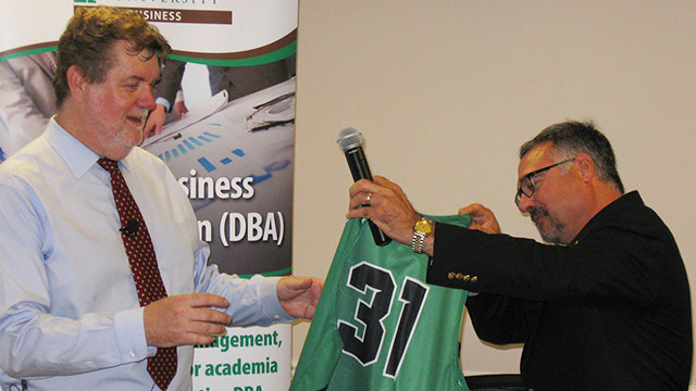 Dr. Dodds receives a Wilmington University jersey from College of Business dean Dr. Robert Rescigno. Dodds is the 31st DBA graduate to have been mentored by Dr. Ruth Norman.