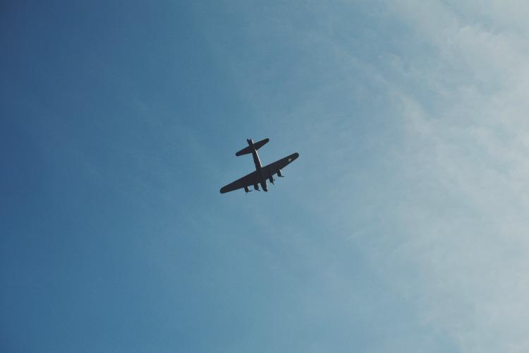 Plane over beach