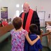 Pastor Steve baptising Gabriel and Sunshyne Hays