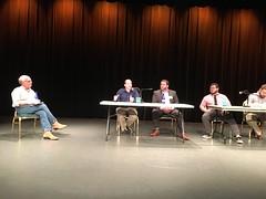 Doc Dawg moderating a panel at his Data & Democracy …