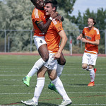 Josh Banton (4) jumps on Thomans Lantmeeters (8) to celebrate a goal_1016