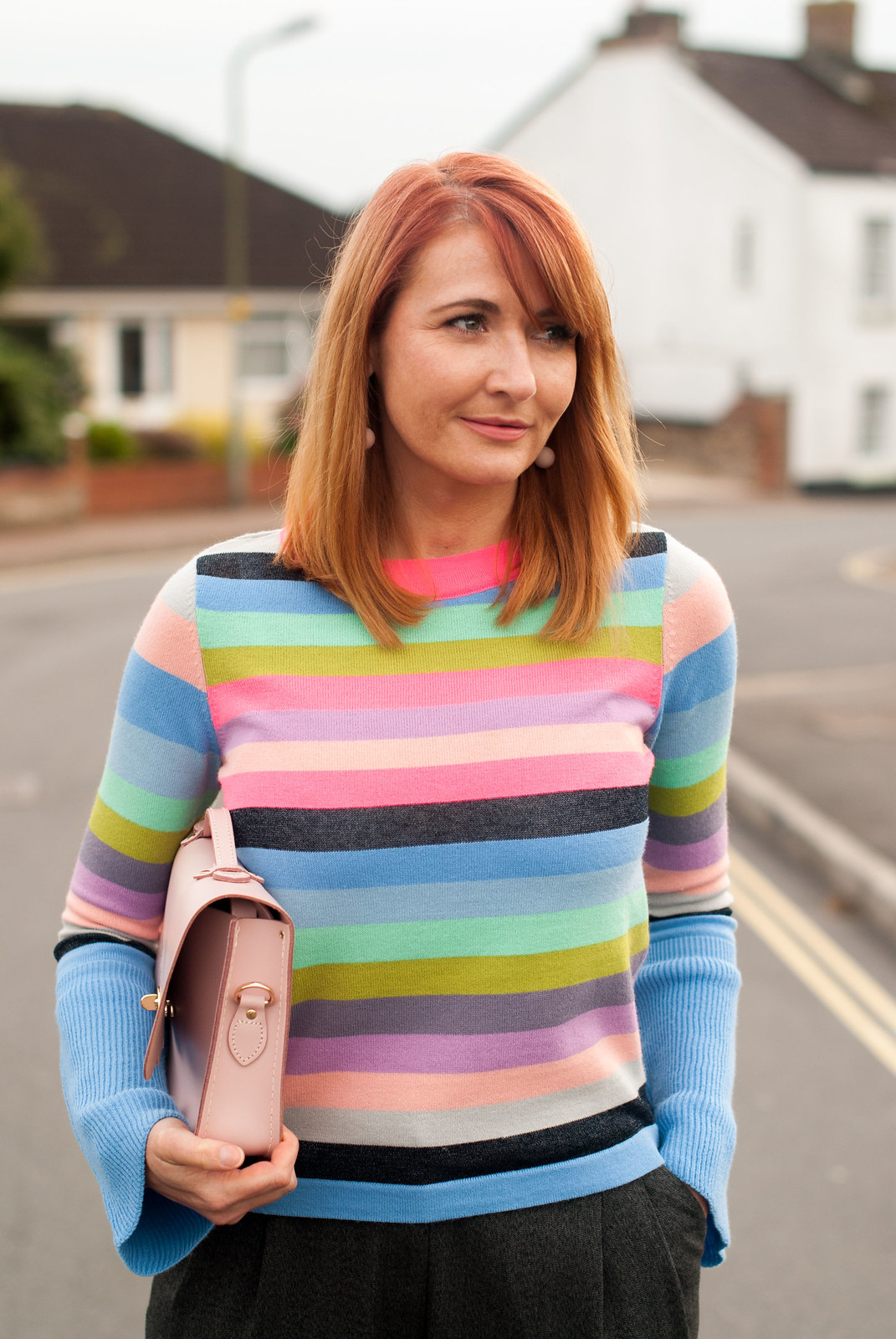 Bright autumnal outfit: Multi-coloured stripe sweater with fluted sleeves grey peg trousers pink suede block heel fringed shoes pink Cambridge Satchel Co Cloud satchel | Not Dressed As Lamb, over 40 style