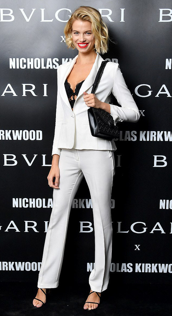 white pant suit with a lace up brallete