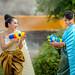 Asian woman playing guns in the Songkran Festival fun.