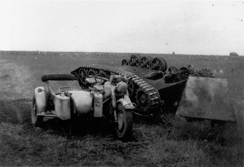 BMW R-75  beside a Destroyed German Borgward  B-IV  near Kursk 1943.