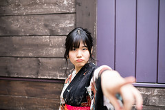 Young woman in yukata pointing me with complaint