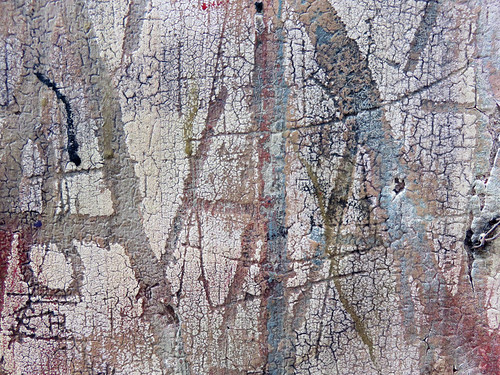Cracked plaster wall texture with letters in Rouen, France