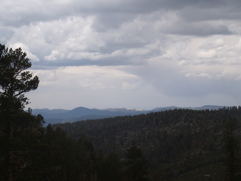 Looking north toward Big Bear under stormy clouds from the Fish Creek Trail near Lake Peak