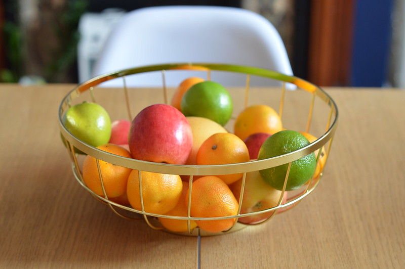 This is a picture of a gold wire fruit bowl