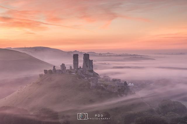 Corfe Castle misty sunrise