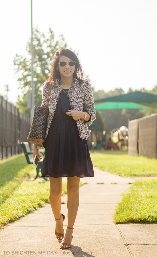 tweed jacket, navy pleated dress, gold watch, patterned tote, brown suede sandals