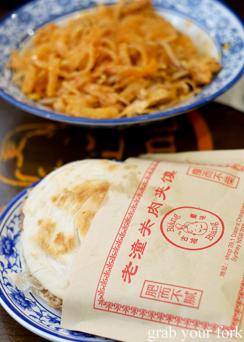 Pulled pork stuffed burger and cold noodles with garlic sauce at Xi'an Biang Biang on Dixon Street in Chinatown Sydney
