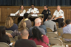 During a forum at Chase Elementary School to discuss police response times, Rep. Stephanie E. Cummings, R-74th District, Waterbury Police Chief Vernon L. Riddick Jr. and Assistant Deputy Chief Edward Appicella and Deputy Chief Fred Spagnolo listen intently as residents offer their feedback, suggestions and complaints.