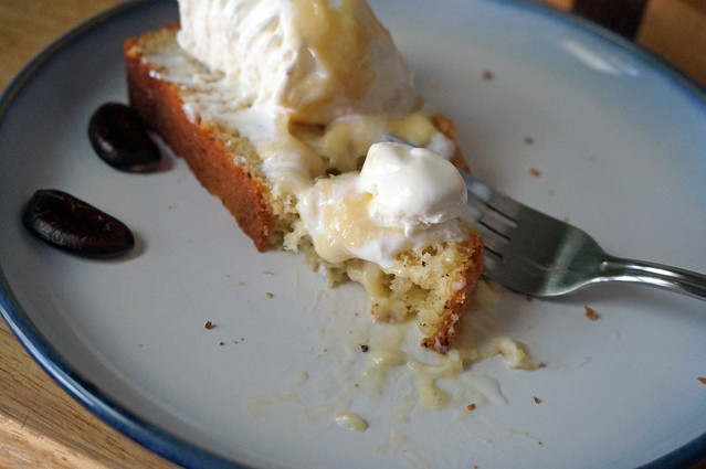 One perfect bite: a bit of cake, a bit of ice cream, and a smear of pawpaw puree, forked up and ready to be eaten. The rest of the serving awaits behind.