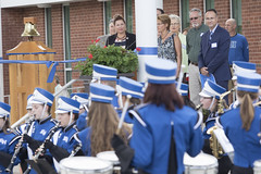 Rep. Melissa Ziobron and other officials listen as the marching band performs before an official ribbon cutting ceremony for the recently renovated and expanded East Hampton High School.