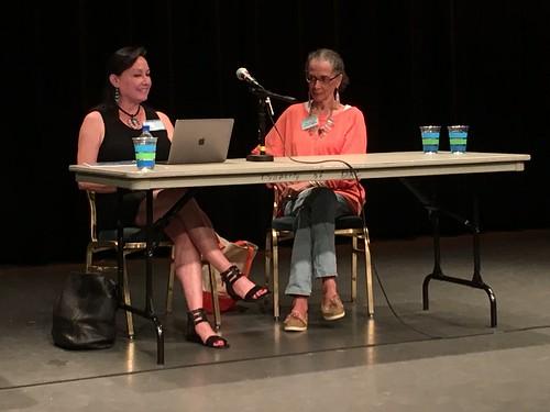 Neeta Lind aka navajo and Denise Oliver Velez sitting on a panel regarding Coalition Building