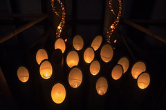Candle lights in bamboo poles
