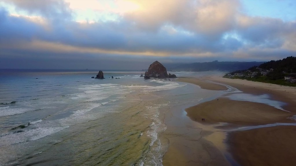 Haystack Rock golden sunset - drone video