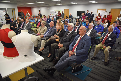 Board of Governors and other campus leaders learn about the latest in wearable technology while visiting the ASSIST labs on Centennial Campus.