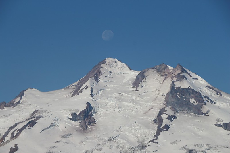 The moon above the summit of Glacier Peak, Washington, from Buck Creek Pass